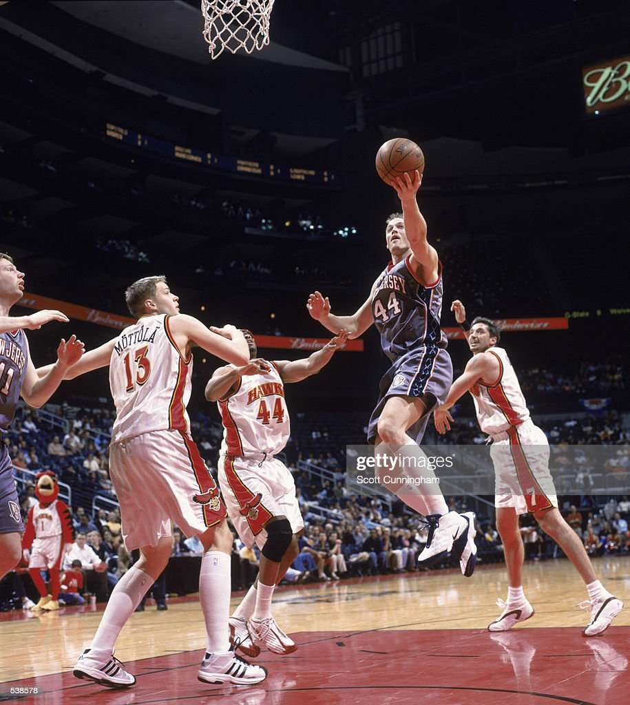 Keith Van Horn leaps for the basket