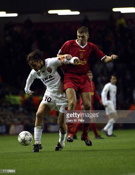 Francesco Totti of AS Roma shields the ball from Steven Gerrard of Liverpool during the UEFA Champions League Second Stage Group B match played at...