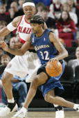 Guard Richard Hamilton of the Washington Wizards drives past forward Bonzi Wells of the Portland Trail Blazers during the NBA game at the Rose Garden...