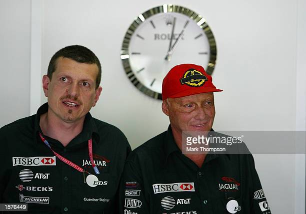 Guenther Steiner and Niki Lauda during qualifying for the FIA Formula One Brazilian Grand Prix at Interlagos Sao Paulo Brazil DIGITAL IMAGE Mandatory...