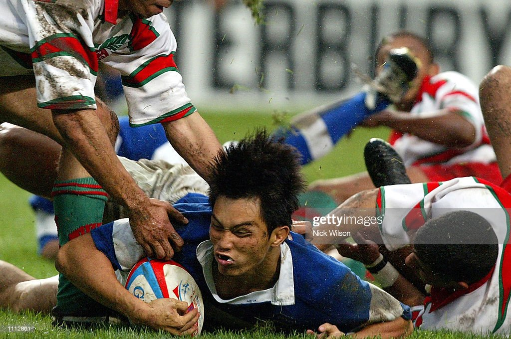 Huang YuMing of Chinese Tapei scores a try during the Bowl Final against Morocco during the Credit Suisse First Boston Hong Kong Sevens being played...