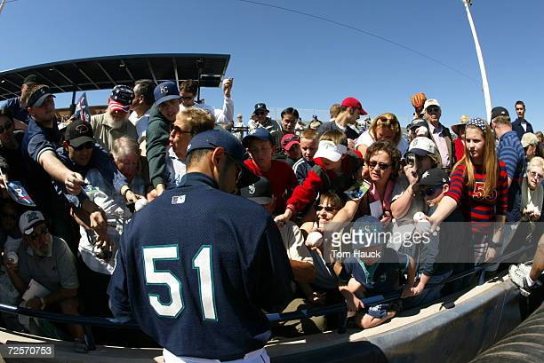 Ichiro Suzuki of the Seattle Mariners signs autographs before the spring training game against the San Diego Padres in Peoria Arizona DIGITAL IMAGE...
