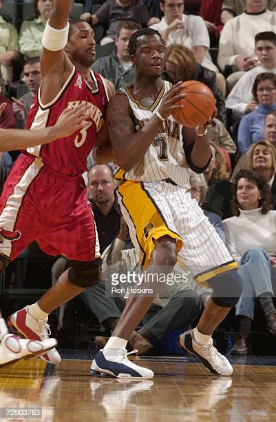 Jermaine O''Neal of the Indiana Pacers being guarded by Shareef AbdulRahim of the Atlanta Hawks during their game at Conseco Fieldhouse in...