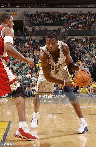 Jermaine O''Neal of the Indiana Pacers being guarded by Shareef AbdurRahim during their game at Conseco Fieldhouse in Indianapolis Indiana The Pacers...