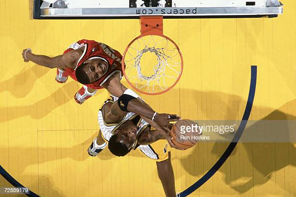 Jermaine O''Neal of the Indiana Pacers dunks the ball while Shareef Abdur Rahim of the Atlanta Hawks attempts to block him during the NBA game at the...