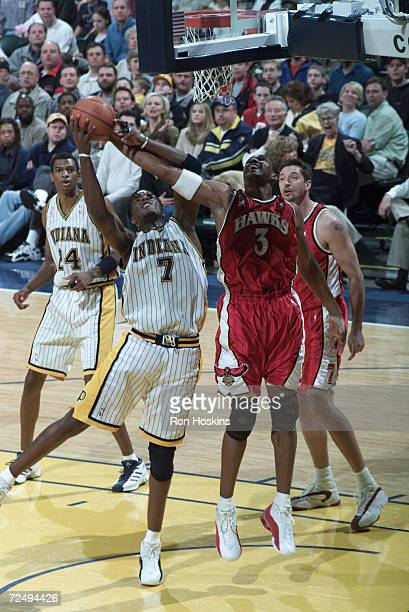 Jermaine O''Neal of the Indiana Pacers rips the rebound from Shareef AbdurRahim of the Atlanta Hawks during a game at Conseco Fieldhouse in...