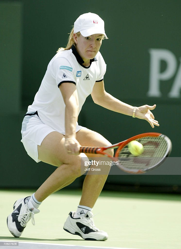 Justine Henin of Belgium hits a backhand during her match against Maja Matevzic at the Indian Wells Tennis Garden in Indian Wells California Henin...