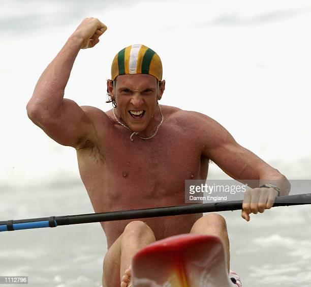 Ken Wallace of Tugun Surf Life Club celebrates winning the under 19 mens Single Ski Final at the 2002 Australian Surf Life Saving Championships at...