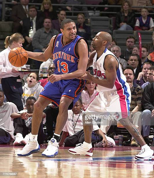 Mark Jackson of the New York Knicks posts up Chucky Atkins of the Detroit Pistons in a game at The Palace of Auburn Hills in Auburn Hills Michigan...