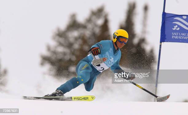 Michael Milton of Australia on his way to gold in the men's LW2 SuperG during the Salt Lake City Winter Paralympic Games at the Snowbasin ski area in...