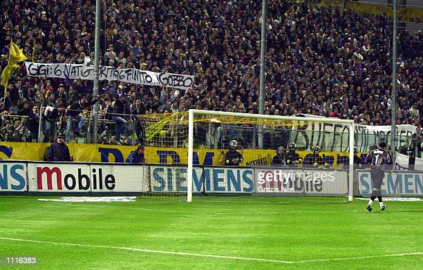 Parma fans goad their former goalkeeper Gianluigi Buffon of Juventus during the Serie A match between Parma and Juventus played at the Ennio Tardini...