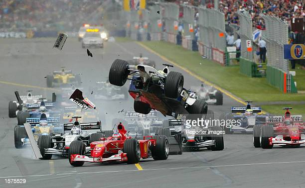 Ralf Schumacher of Germany and the BMW Williams Formula One Team Gets airborne after clipping the Ferrari of Rubens Barrichello at the 2002 Fosters...