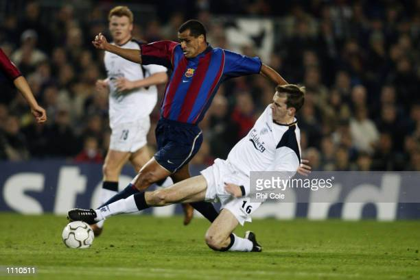 Rivaldo of Barcelona takes the ball past Dietmar Hamann of Liverpool during the UEFA Champions League Group B match played at the Nou Camp in...