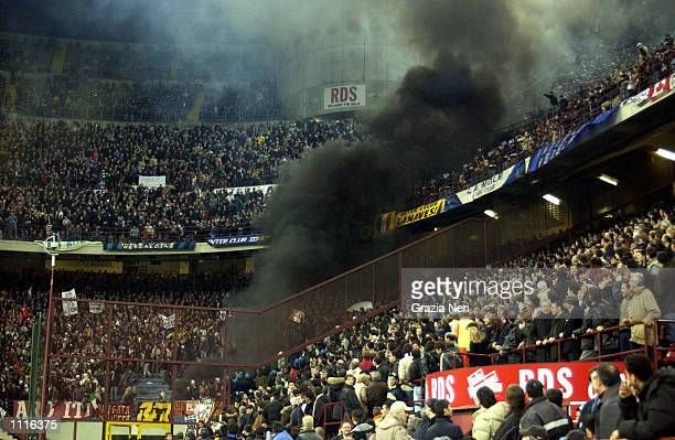 Roma fans watch the action during the Serie A match between Inter Milan and Roma played at 'Giuseppe Meazza' Stadium San Siro Milan DIGITAL IMAGE...