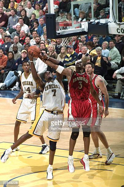 Shareef AbdurRahim of the Atlanta Hawks blocks the shot of Jermaine O''Neal of the Indiana Pacers during their game at Conseco Fieldhouse in...