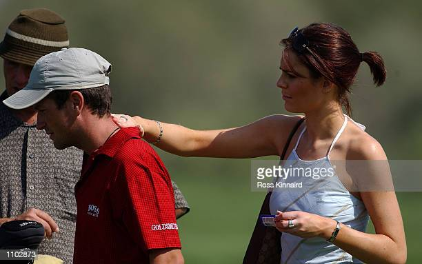 Susie Amy ''Chardonny'' form the TV series Footballers Wives puts sun cream on the back of boyfriend and golfer Steve Webster of England on the 3rd...