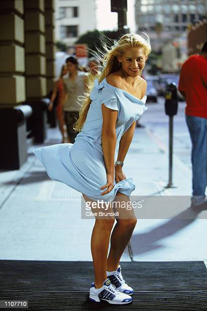 Tennis star Anna Kournikova of Russia recreates a legendary Marilyn Monroe pose during the filming of the adidas climacool commercial on location in...
