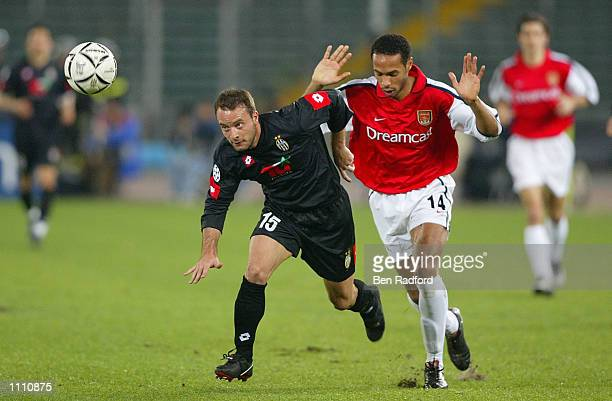 Thierry Henry of Arsenal and Alessandro Birindelli of Juventus in action during the UEFA Champions League match between Juventus and Arsenal at Delle...