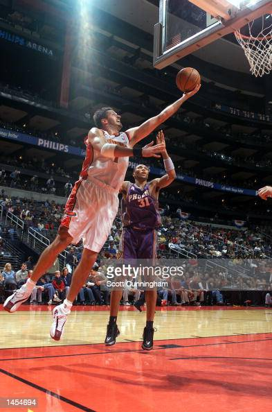 Toni Kukoc of the Atlanta Hawks goes for a layup against Shawn Marion of the Phoenix Suns at Philips Arena in Atlanta Georgia Digital Image NOTE TO...