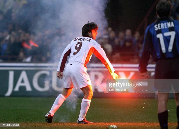 Vincenzo Montella of Roma throw away a firework during the SERIE A 28 th Round League match Inter and Roma played at the San Siro Stadium Milan