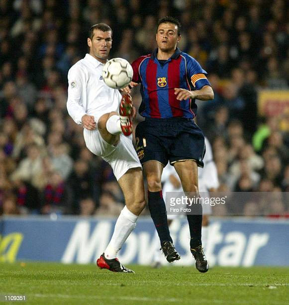 Zinedine Zidane of Real Madrid and Luis Enrique of Barcelona in action during the Primera Liga match between Barcelona and Real Madrid played at the...