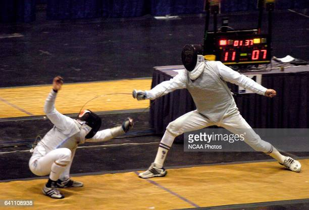 Boaz Ellis of Ohio State and Gabriel Sinkin of New York University battle for first place during the finals in the Men's Foil during the Division 1...