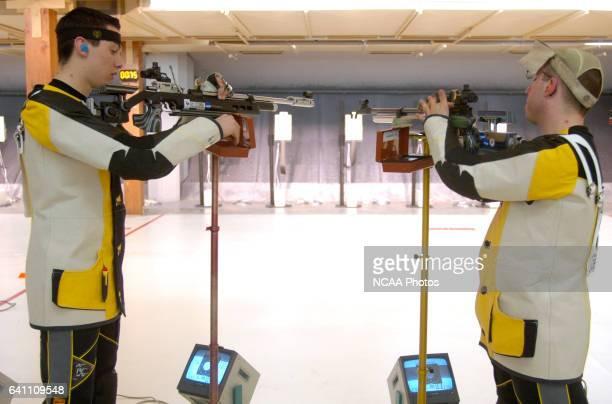 Chris Abalo and Lucas Leinberger of the United States Naval Academy reload their rifles during the Division I Men's and Women's Rifle Championship...