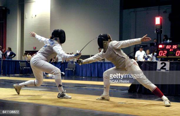 Metta Thompson of Ohio State and leanda Ferland of Sacred Heart battle for points in the foil during the Division 1 Women's Fencing Championship held...