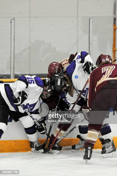 Stephanie Clegg and Megan Curry of Amherst College fight for control of the puck against Brittane Michaud of Norwich University during the Division...