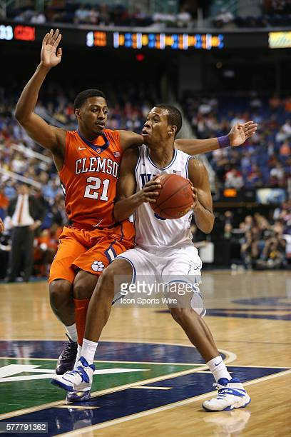 Clemson Tigers guard Damarcus Harrison guards Duke Blue Devils forward Rodney Hood during the ACC Mens Basketball Tournament Championship at the...