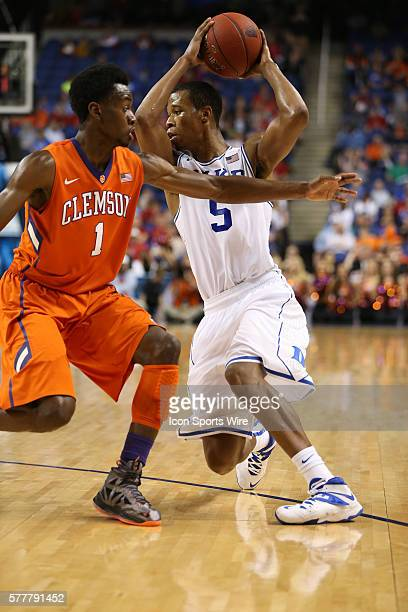Duke Blue Devils forward Rodney Hood fakes out Clemson Tigers guard/forward Austin Ajukwa during the ACC Mens Basketball Tournament Championship at...
