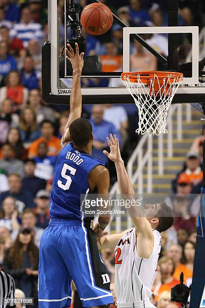 Duke Blue Devils forward Rodney Hood on a jumper over Virginia Cavaliers guard Joe Harris during the ACC Mens Basketball Tournament Championship at...