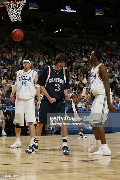 Mar 23 2006 Oakland CA USA NCAA Basketball The Gonzaga Bulldogs Adam Morrison against the UCLA Bruins Cedric Bozeman and Lorenzo Mata during...