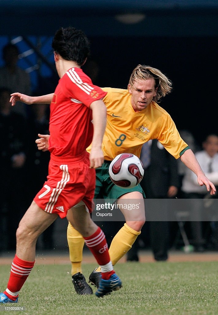 Mar 24, 2007, Guangzhou, China, Brett Holman of Australia (R) vies with <a gi-track='captionPersonalityLinkClicked' href=/galleries/search?phrase=Sun+Jihai&family=editorial&specificpeople=228898 ng-click='$event.stopPropagation()'>Sun Jihai</a> of China during a warm-up football match between China and Australia. Australia won 2:0.