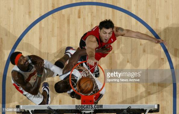 Mar 31 2008 Charlotte North Carolina USA Toronto Raptors guard CARLOS DELFINO slam dunks against the Charlotte Bobcats in Charlotte NC The Toronto...