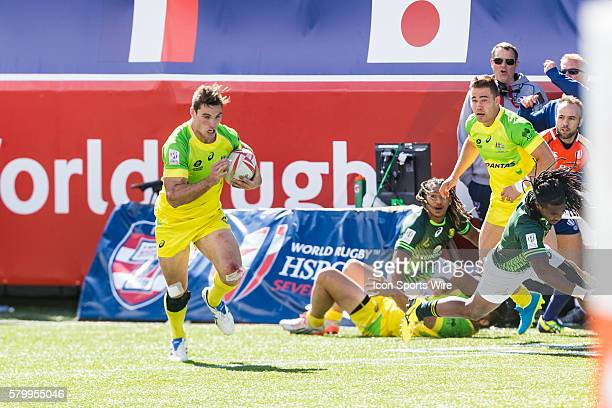Ed Jenkins of Australia with time expired sets off for the try line during the Cup Semi final match between South Africa and Australia at the USA...