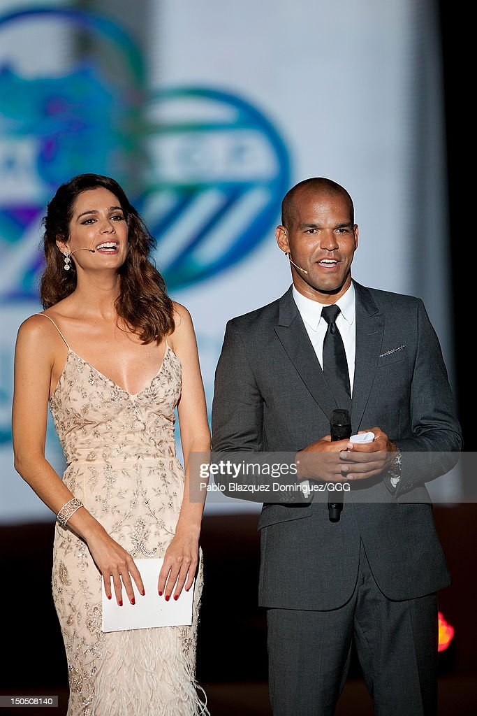 Mar Saura (L) and Amaury Nolasco (R) present the Global Gift Gala held to raise benefits for Cesare Scariolo Foundation and Eva Longoria Foundation on August 19, 2012 in Marbella, Spain.