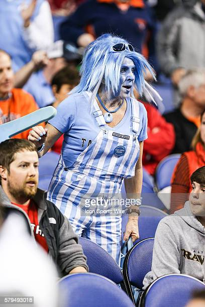 North Carolina Tar Heels fan in her overalls and wig during the ACC Tournament game at Greensboro Coliseum in Greensboro NC North Carolina moves to...