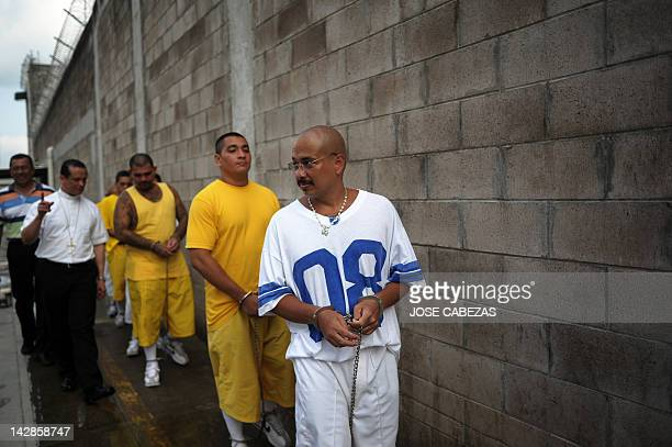 Mara 18 gang member Carlos Alberto Rivas aka El Chino tres colas is walked to his cell after a mass at the Izalco Penitenciary in the city of Izalco...