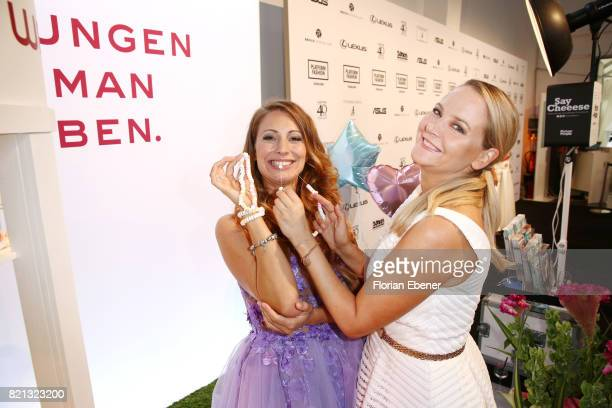 Mara Bergmann and Tiana Pongs attend the Thomas Rath show during Platform Fashion July 2017 at Areal Boehler on July 23 2017 in Duesseldorf Germany