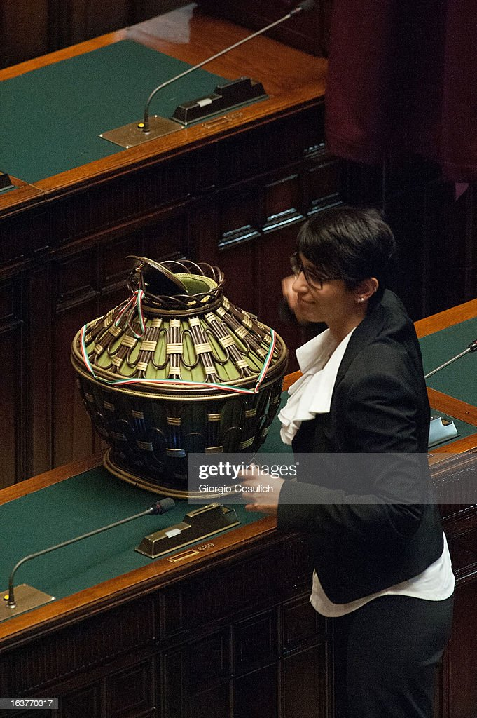 Mara Mucci, deputy of the Five Stars Movement, places the ballot during the first meeting of the new Italian parliament on March 15, 2013 in Rome, Italy. The new Italian parliament, which opens the 17th Legislature, has the task of electing the President of the House of Parliament and of the Senate, before giving way to a new government. Pier Luigi Bersani, leader of the Democratic Party, asked his senators and representatives to vote blank votes with the intent to continue to work on an agreement with the Five Stars Movement (M5S) who instead said that it will vote only for its candidates for the presidency of House of Parliament and the Senate.