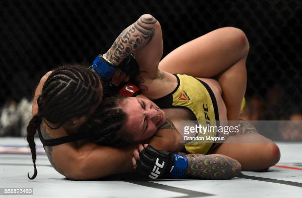 Mara Romero Borella of Italy secures a rear choke submission against Kalindra Faria of Brazil in their women's flyweight bout during the UFC 216...