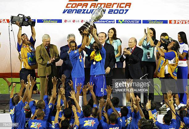 Brazilian players Gilberto Silva and Juan raise the trophy after Brazil won the Copa America 2007 final match against Argentina at the Pachencho...