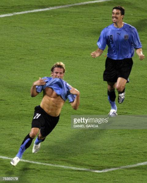 Uruguay's forward Diego Forlan celebrates after scoring against Brazil as teammate defender Andres Scotti follows him during their Copa America...