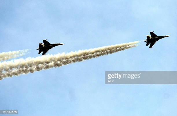 Two Russian Sukhoi aircrafts fly over the Venezuelan Air Force airport in Maracay 100km away from Caracas Venezuela 10 December 2006 AFP PHOTO/Jenny...
