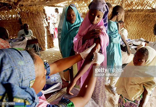 A woman is vaccinated against meningitis 17 March 2006 in Tchadoua near Maradi in South west Niger Doctors without boarders the Red Cross and the...