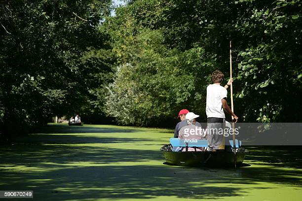 Marais Poitevin in the Vendee department photograph library of Vendee Boat trip on the Marais Poitevin tourism tourist activity tourists in a a boat...