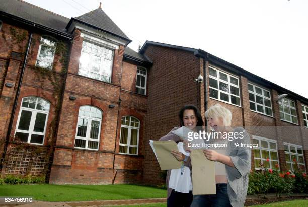 Maral Rouhani who achieved five A grades celebrates with Katharine Hamlett who achieved four A grade ALevels at Withington Girls School in Manchester