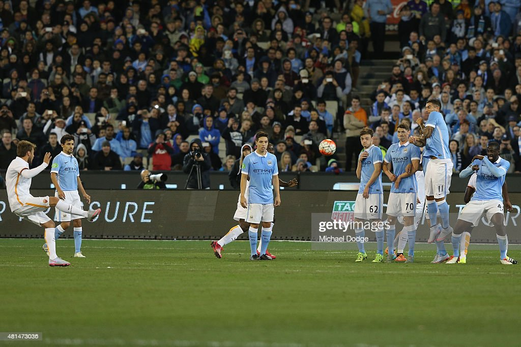Maralem Pjanic of AS Roma kicks a goal during the International Champions Cup match between Manchester City and AS Roma at Melbourne Cricket Ground on July 21, 2015 in Melbourne, Australia.