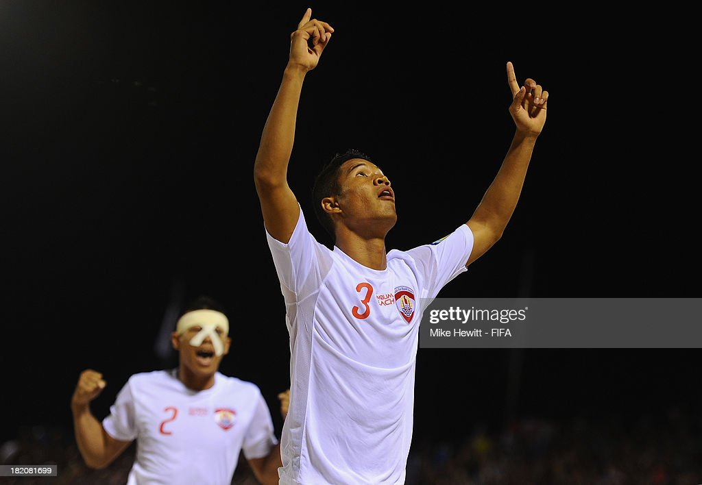 Marama Amau of Tahiti celebrates after scoring during the FIFA Beach Soccer World Cup Tahiti 2013 Semi Final match between Russia and Tahiti at the Tahua To'ata Stadium on September 27, 2013 in Papeete, French Polynesia.